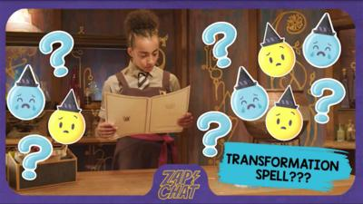 A young witch (Indigo) in Cackle's Academy uniform looks confused holding a spell scroll.