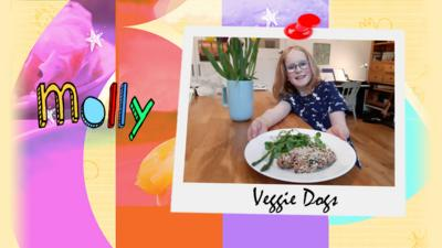 A girl shows a plate of the vegetarian hot dogs that she has made.