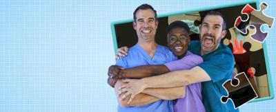 Thee doctors wearing different coloured scrubs, hugging each other in front of a picture of a giant jigsaw.