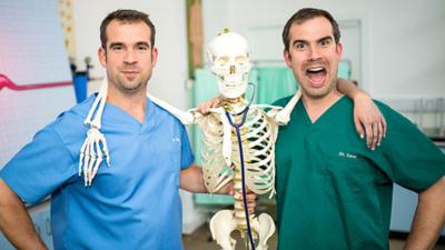 Dr Chris and Dr Xand posing with a skeleton