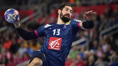 France's Nikola Karabatic jumps to shoot on goal during the match for third place of the Men's 2018 EHF European Handball Championship between France and Denmark on January 28, 2018