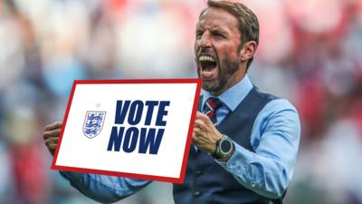 Gareth Southgate holding a plaque saying vote now