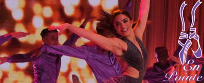 A girl (Piper) dancing and smiling in formation with The Next Step, with a purple ballet shoes icon in the corner.