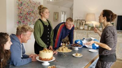 Ramsay family at a table with cakes