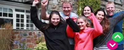Tilly Ramsay and her family smiling with their arms in the air