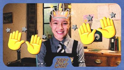 Girl looking happy with emoji hands and a crown placed on the image. Felicity Foxglove from The Worst Witch.