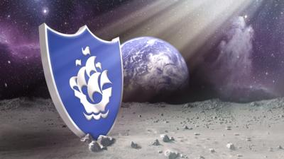 A giant Silver Blue Peter badge on the moon.