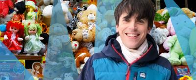Presenter Ed Petrie in front of a cuddly toy collection.
