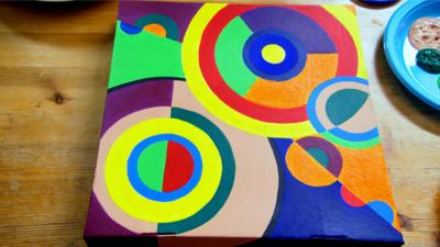 Abstract painting on a pizza box.