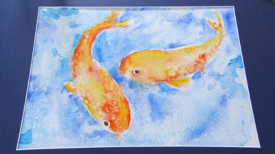 Watercolour painting of two fish.