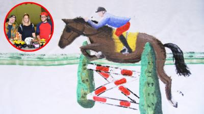 Large painting of a horse jumping over a fence.