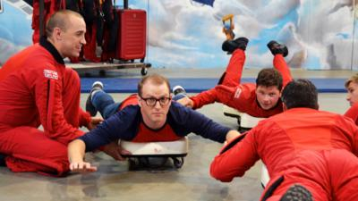 Ricky forms a skydive formation with the Red Devils.