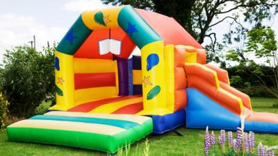 A book on a bouncy castle.
