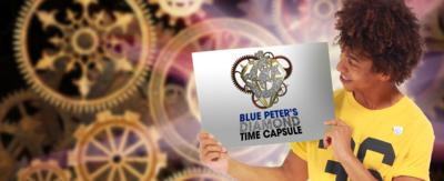 Radzi holding a card saying Blue Peter's Diamond Time Capsule.