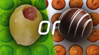 """An olive, the word """"or"""" and a chocolate truffle, with cupcakes in the background"""