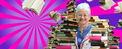 Jacqueline Wilson surrounded by books.