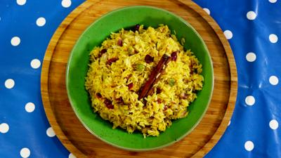 Biryani rice with pistachios and cranberries in it.