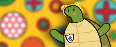 Shelley the Tortoise wearing Pudsey ears.