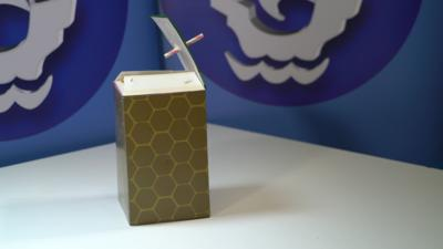 Straw in top of cardboard