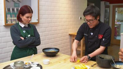 Jeremy Pang from School of Wok shows Lindsey how to fold the wonton.