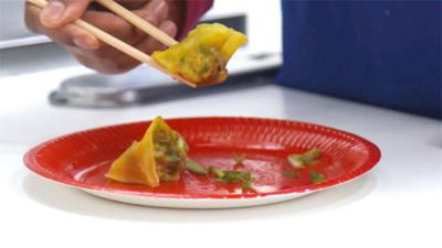 Wontons on a red plate.
