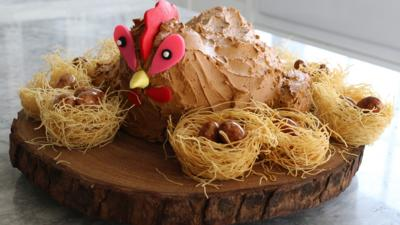 A cake in the shape of a hen.