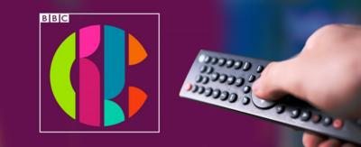 A TV remote and the CBBC logo.