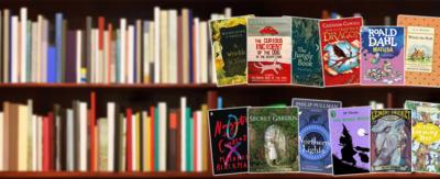 A book shelf, showing various children's books, including (from top left to bottom right): A Wrinkle in Time, The Curious Incident of the Dog in the Night-time, The Jungle Book, How to Train Your Dragon, Matilda, Winnie-the-Pooh, Noughts & Crosses, The Secret Garden, The Northern Lights, The Worst Witch, A Series of Unfortunate Events: A Bad Beginning, The Magic Faraway Tree.