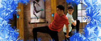 Ozzy and Kingston from The Next Step perform some acrobatic dance moves within a frosted picture frame.