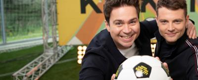 Two guys are holding a football. Text reads 'Can You Kick It?'. Sam and Mark.