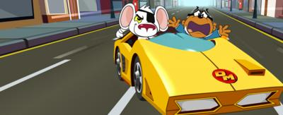 Danger Mouse (a white mouse with an eye patch) and Penfold (a brown mole in a suit) are sat in the driving and passanger seats of the Danger Mouse Mobile, speeding down the streets on London!