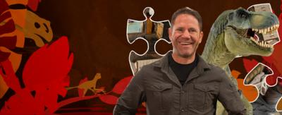 Steve Backshall and a T-Rex with a dinosaur graphic background and some jigsaw pieces.