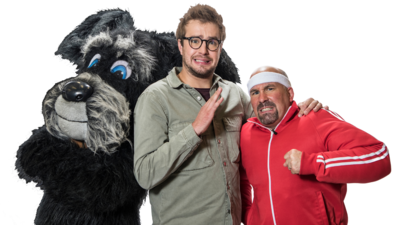 Two men and a person dressed as a dog.