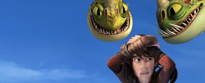 Hiccup - from the Dragons series with his hands on his head as Barf and Belch (dragons) look at him.