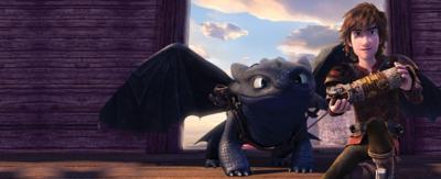 A cartoon boy sat with a black dragon.