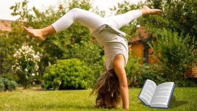A girl doing a handstand while reading.