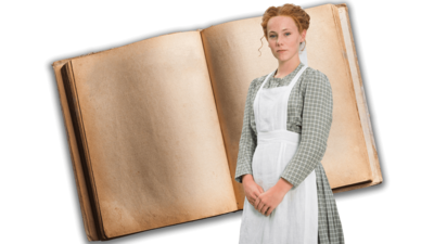 A red-haired girl in a Victorian serving girl's costume stands with her hands clasped in from of her in front of an open book.