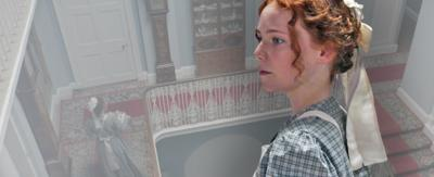 Hetty stands looking concerned, behind her is a faded image of a grand staircase.