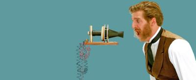 Alexander Graham Bell shouts into a prototype of a telephone.