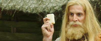 A viking holding soap.