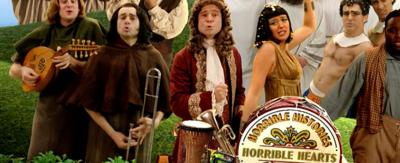 Horrible Histories characters recreating the Sgt Pepper's cover.