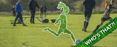 A cut out of a figure playing football.
