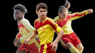 Jamie, Alba and Freddie playing football.