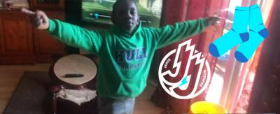 A boy celebrating his Jamie Johnson socker challenge. Click to watch a montage.