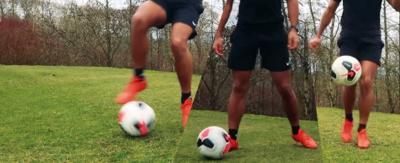 A footballer with a ball at their feet.