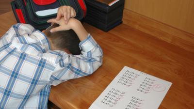 boy with head down on desk failed test