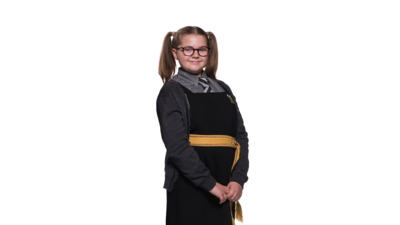 A girl in a school uniform with her hair in bunches and wearing glasses. Maud from The Worst Witch.