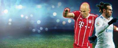 A footballer in a red Bayern Munich kit is running on the left of the image (Arjen Robben). A football player in white Real Madrid kit is running on the right of the image (Gareth Bale).