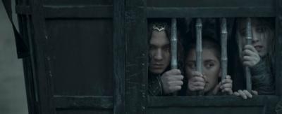 Three people trapped in behind bamboo bars, Monkey, Tripitaka and Sandi.