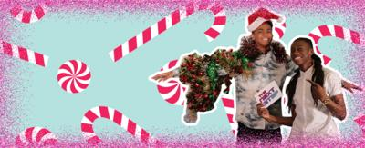 Two boys posing. One is decorated with tinsel and wearing a santa hat. Pink glitter border and candy cane background. Kingston and Henry from The Next Step.